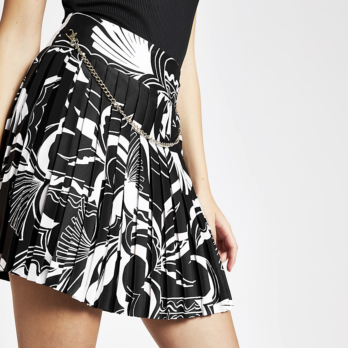 White print pleated mini skirt