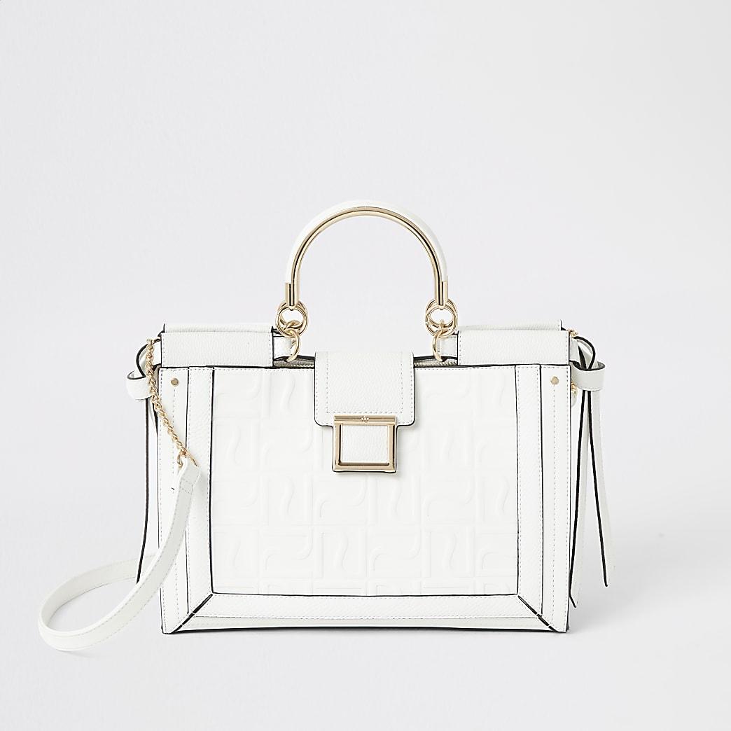 Witte handtas met RI-monogram en metalen hengsel