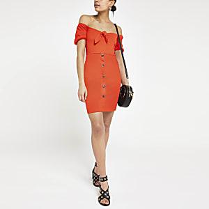 Mini robe Bardot rouge nouée sur le devant