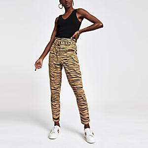 Beige jeans met tijgerprint en ingesnoerde taille