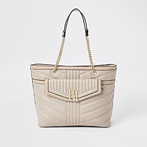 Lichtroze doorgestikte handtas met voorvak