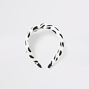 Witte plissé hoofdband met knoop voor en stippen