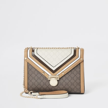 Dark beige RI monogram quilted cross body bag