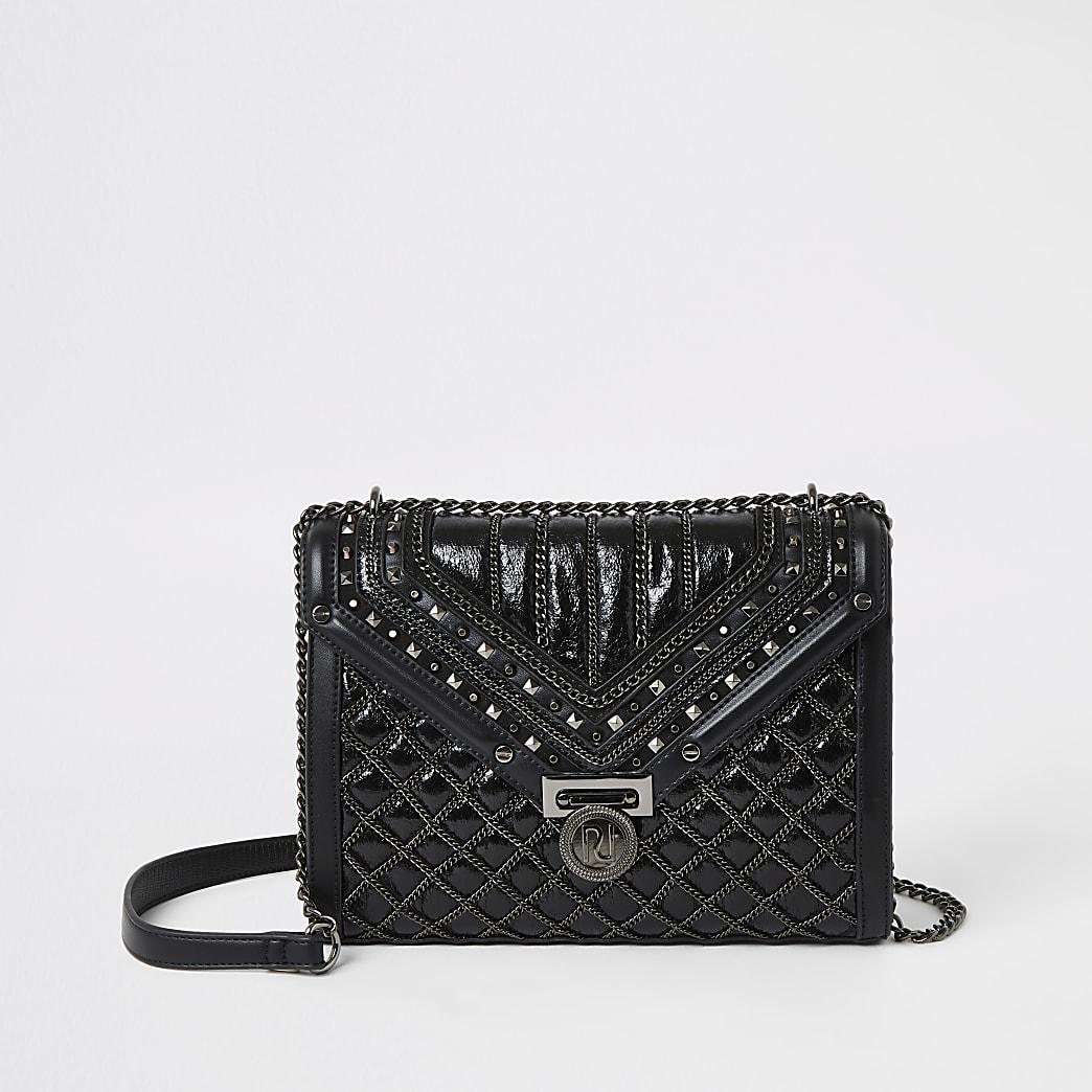 Zwarte doorgestikte crossbodytas met studs