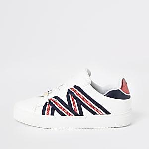 Baskets blanches à bandes et lacets