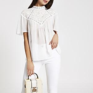 Witte kanten geborduurde blouse