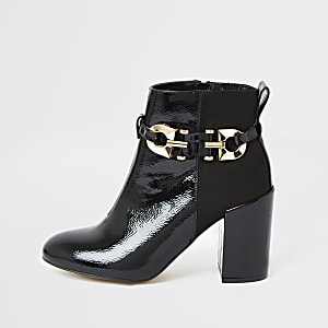 Black patent buckle heeled ankle boots