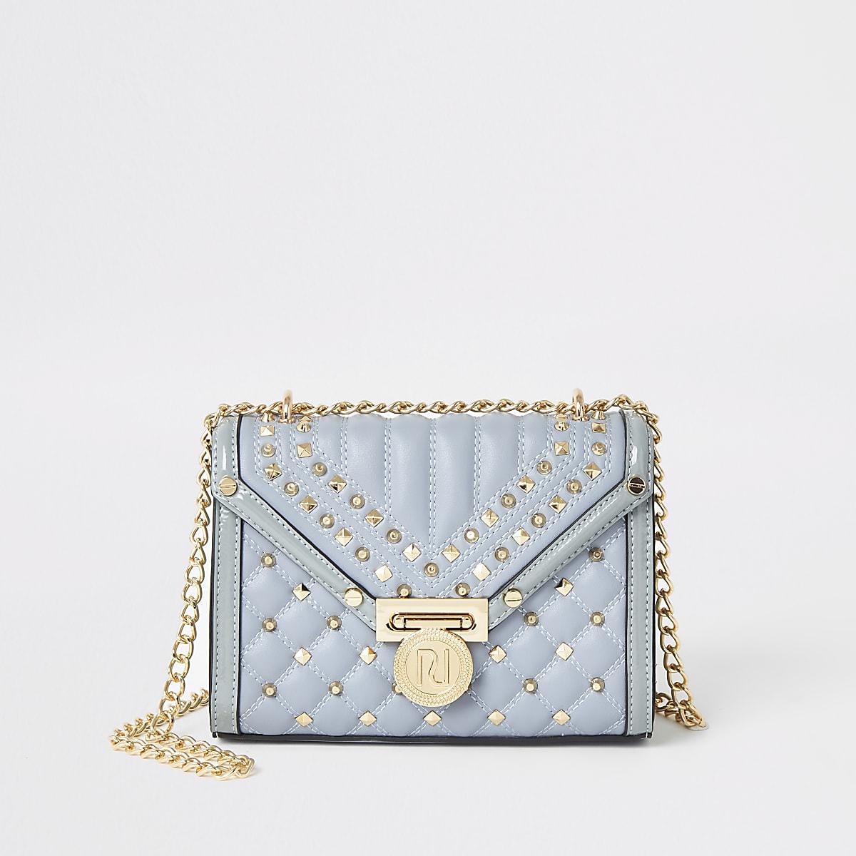 Lichtblauwe doorgestikte crossbodytas met studs