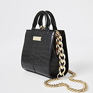 Kleine zwarte tas met krokodillenreliën en handvat