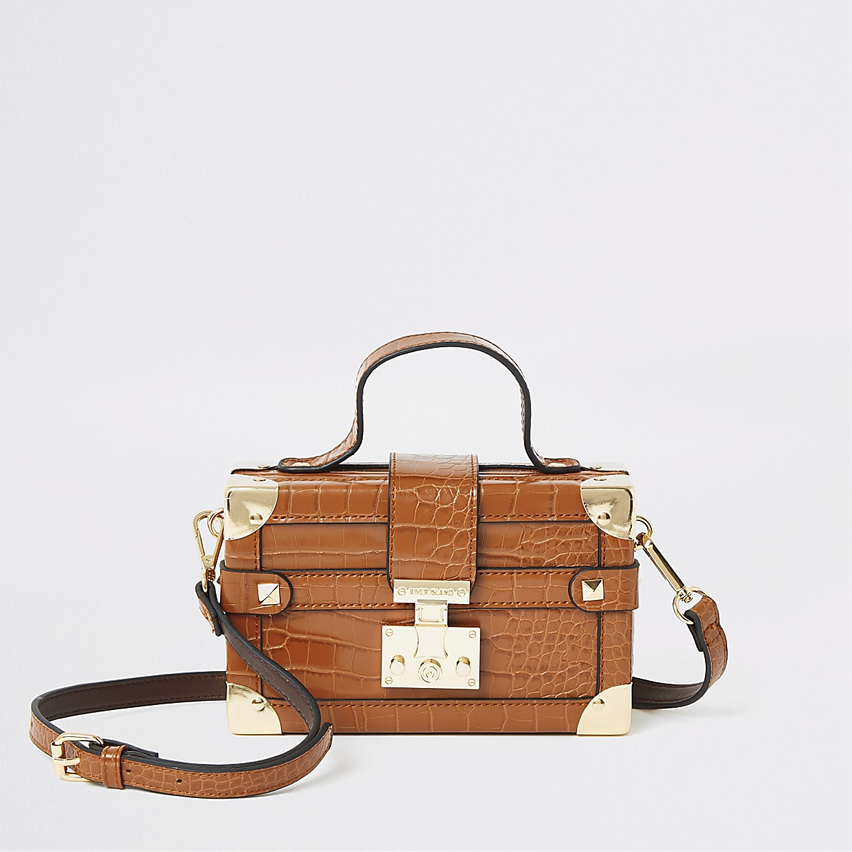 Brown lock front trunk cross body bag