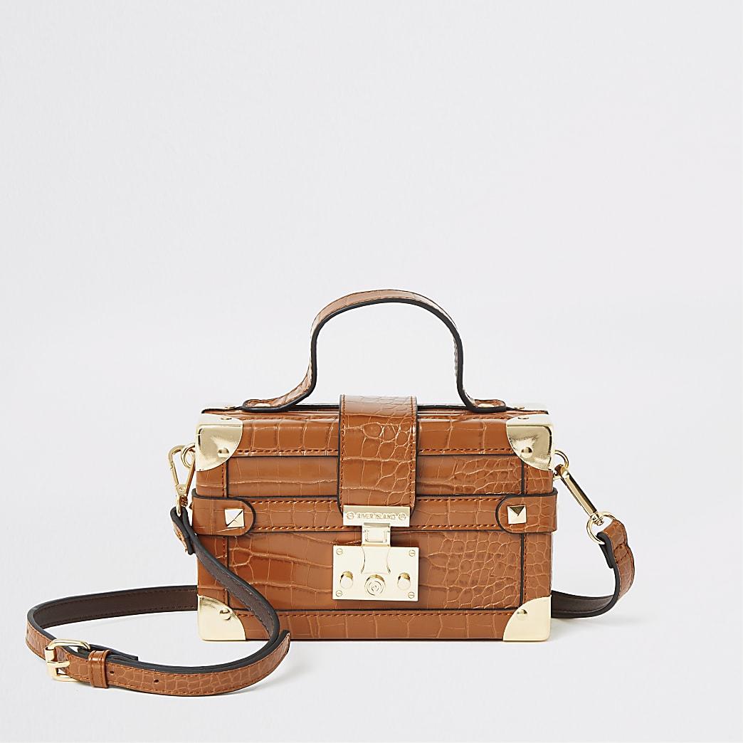 Brown lock front trunk cross body bag