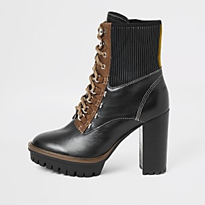 Black heeled lace up hiking boots