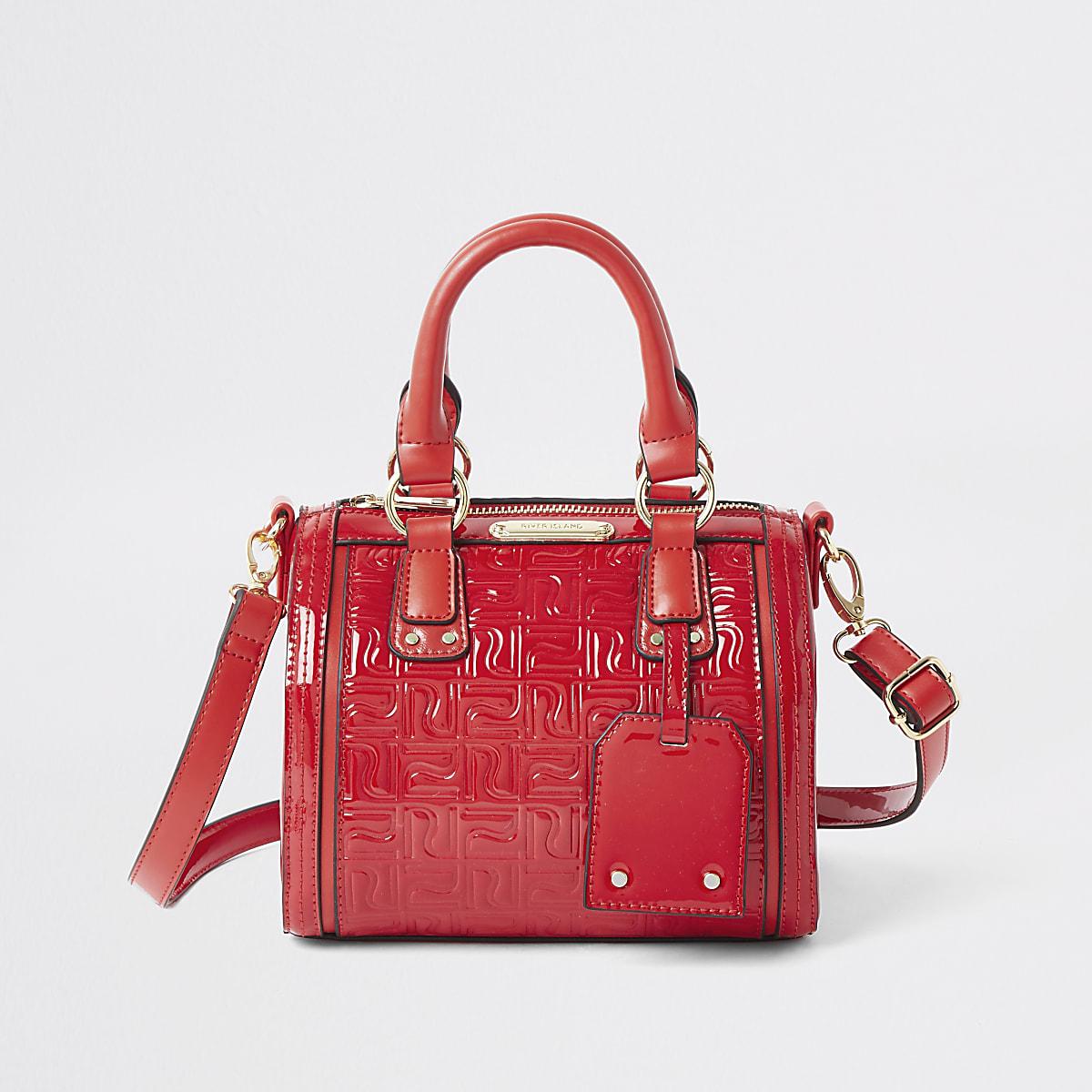 Rode tas met RI-monogram