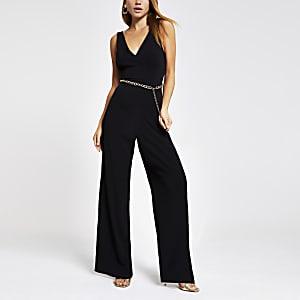 Zwarte jumpsuit met kettingriem