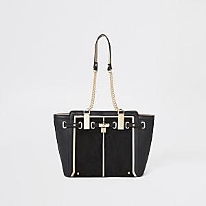 Zwarte handtas met zij-inzetten en hangslotje