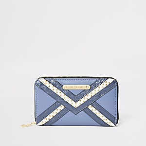 Blauwe portemonnee met rits rondom en studs
