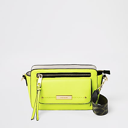 Neon yellow pocket front cross body bag