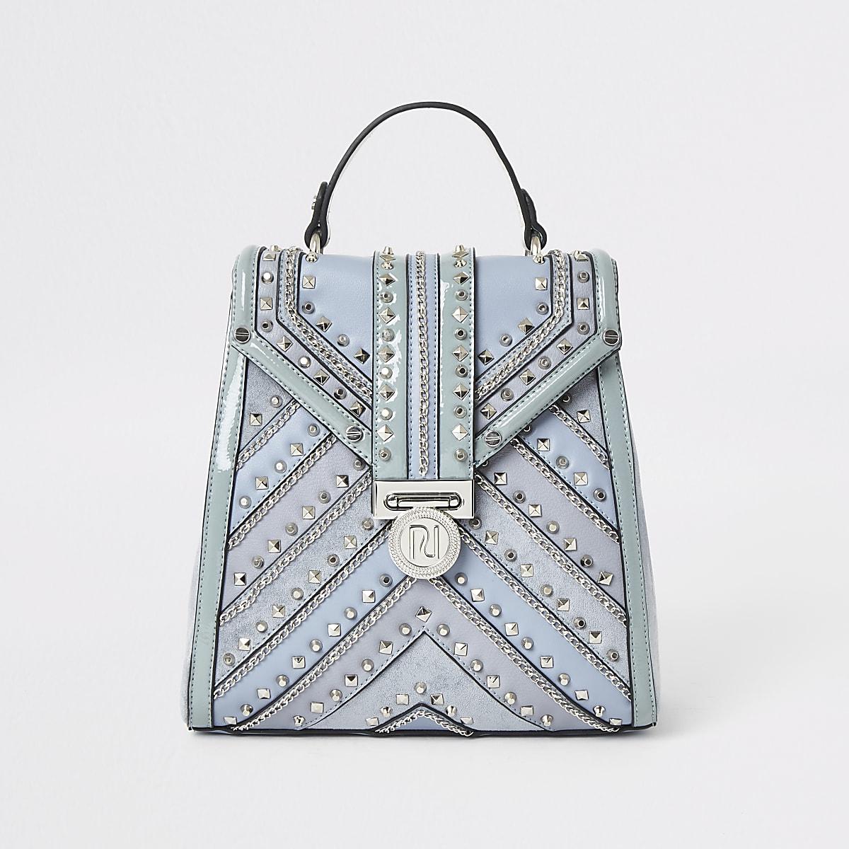 Light blue studded backpack