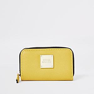Petit porte-monnaie jaune zippé sur le pourtour