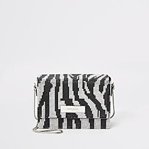 Zilverkleurige mini-crossbodytas met diamantjes en zebraprint