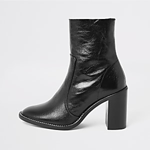 Black leather heeled sock boots
