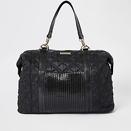 Black quilted weekend travel bag
