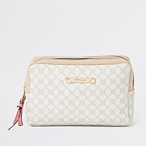 Light pink RI monogram zip top makeup bag