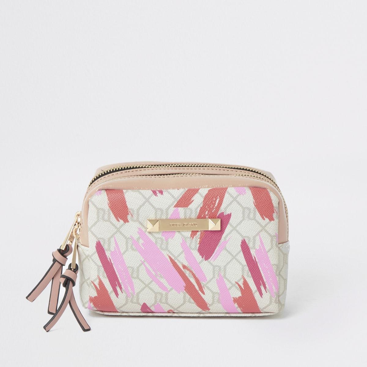 Light pink RI monogram lipstick makeup bag