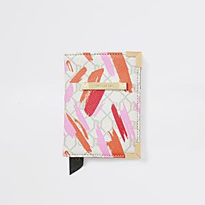 Porte-passeport rose clair avec logo RI imprimé