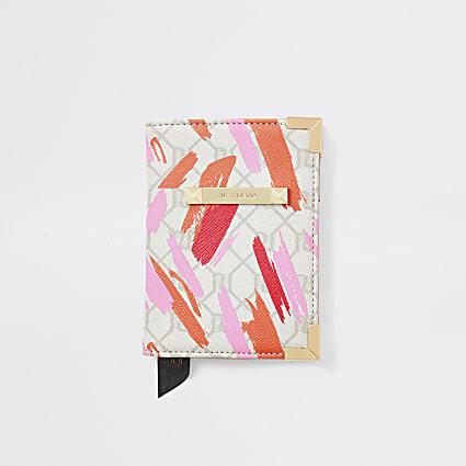 Light pink RI monogram passport holder