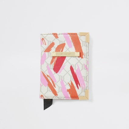 Light pink RI monogram passport holder