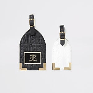 Zwarte set bagagelabels met RI in reliëf