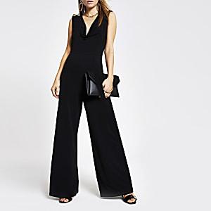 Zwarte jumpsuit met losvallende col en wijde pijpen