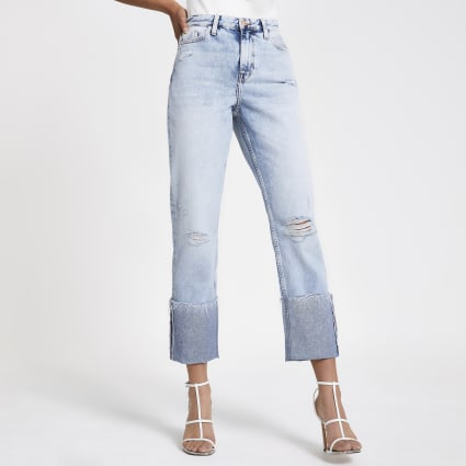 Light blue denim rolled hem ripped jeans