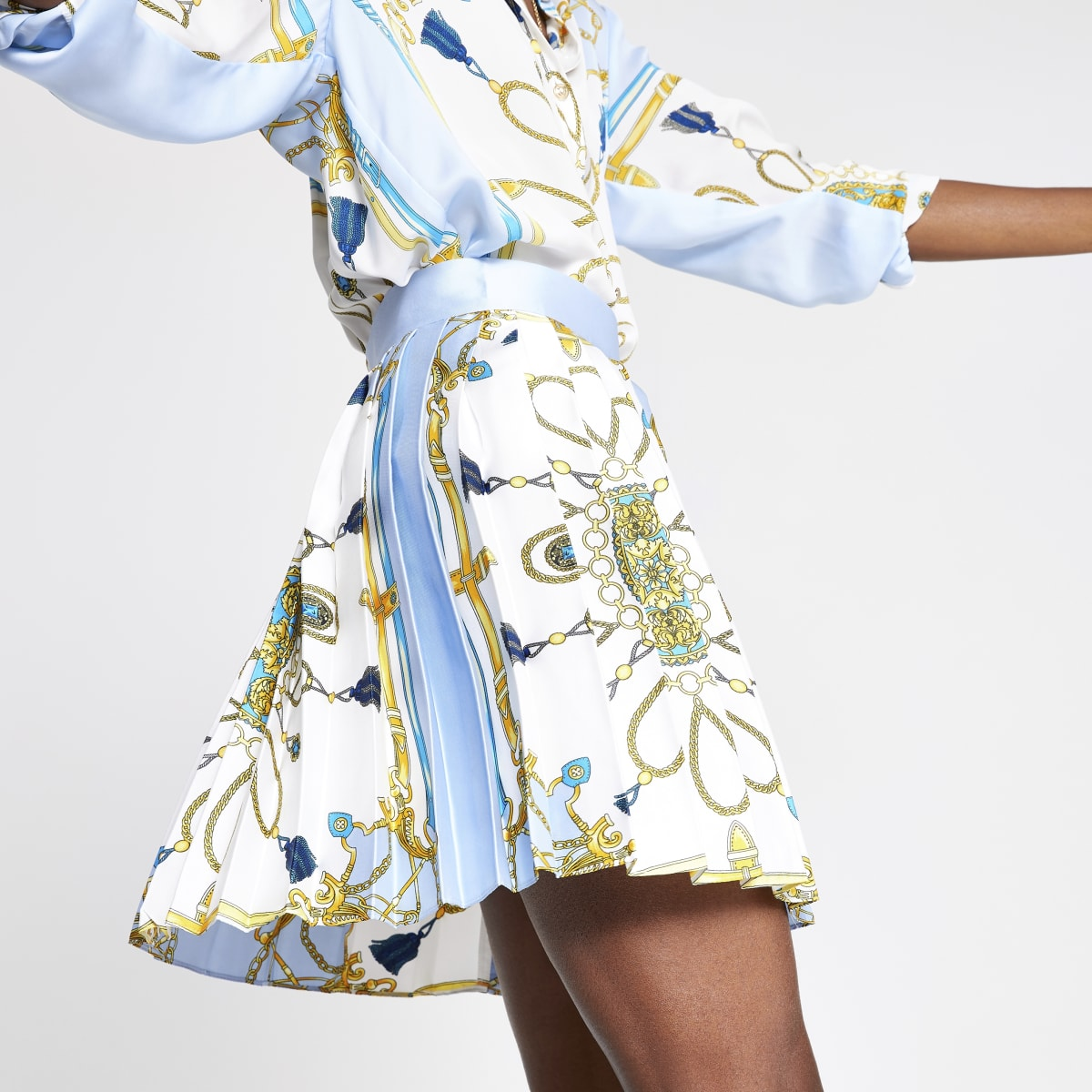Light blue print pleated mini skirt