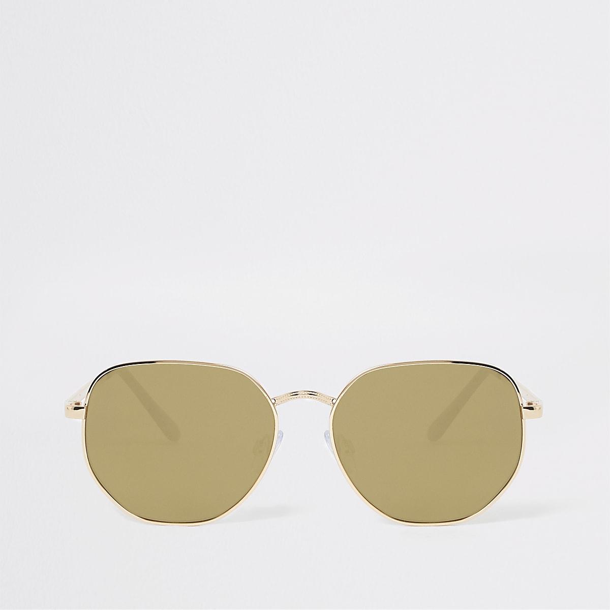 Goudkleurige zonnebril met zeshoekige glazen