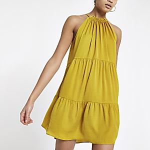 Gele swingjurk met halternek