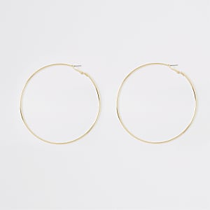 Caroline Flack gold colour hoop earrings