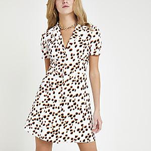 Witte jurk met stippen