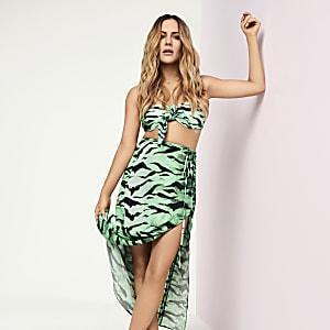 Caroline Flack green zebra print midi skirt