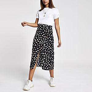Caroline Flack black print midi skirt