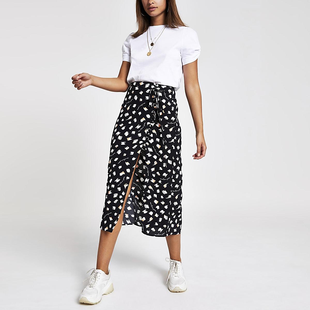 Caroline Flack black polka dot midi skirt