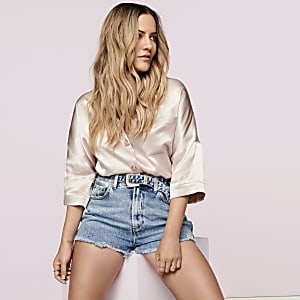 Caroline Flack light pink curved hem shirt