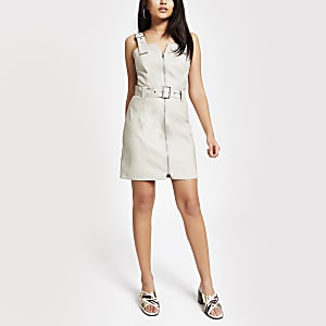 Cream faux leather belted pinafore dress