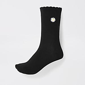 Schwarze Sneakersocken mit Streublumen