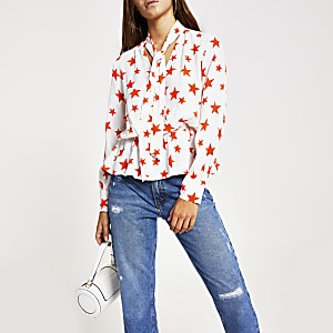 Cream star print tie neck long sleeve top