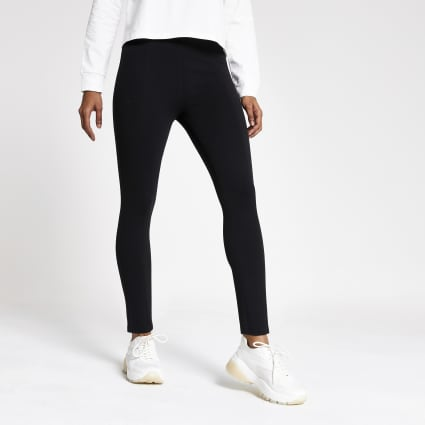 Petite black jersey panelled leggings