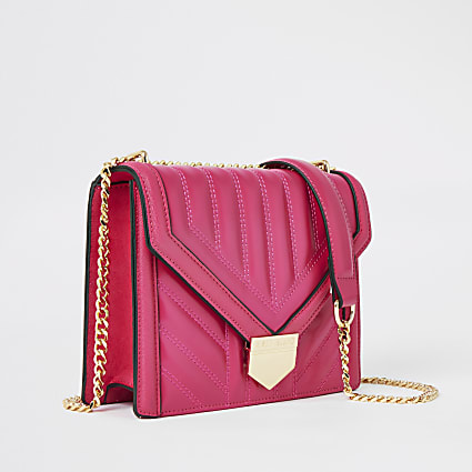 Bright pink quilted underarm bag