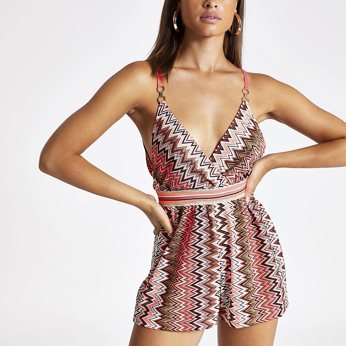 Roze strandplaysuit met zigzagprint