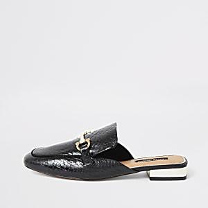 Zwarte leren loafers met open hiel en gespdetail